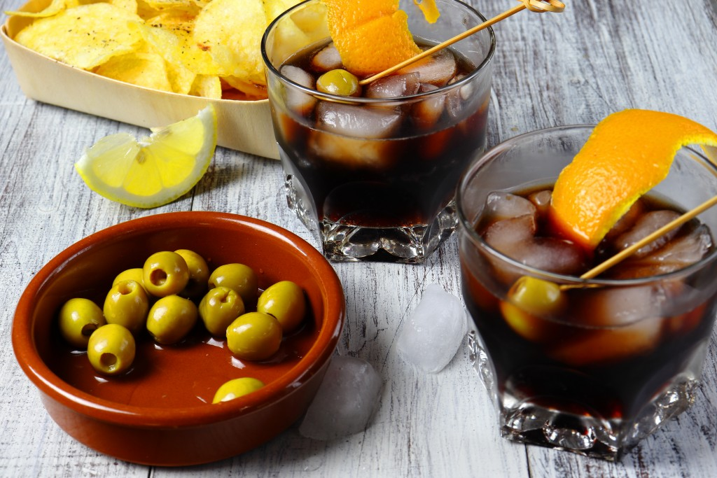 typical spanish appetizer, with vermouth, olives and fried potatoes with pepper and lemon